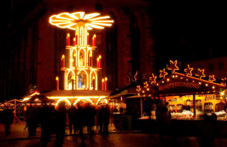 Christmas market with people, candles and stores in Heidelberg, Germany