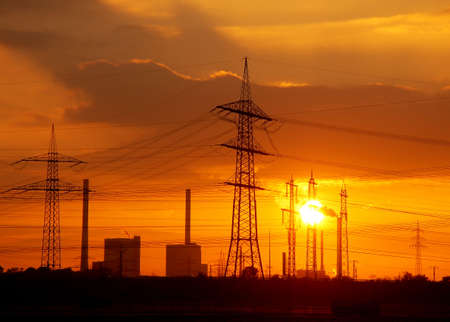 sunup: Sondown behind a coal fired power plant with power poles