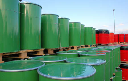 gasoil: Assembly of green and red oil drums on an industrial site
