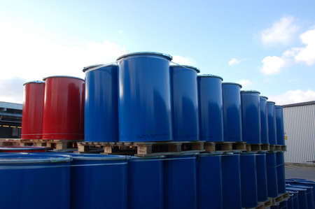 gasoil: Red and blue oil barrels on an industrial site