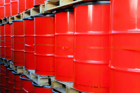 Assembly of red oil drums on palettes