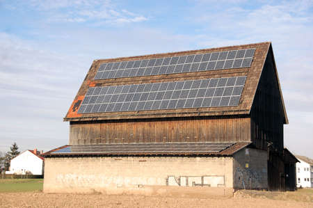 Solar collectors on the roof of a farmhouse photo