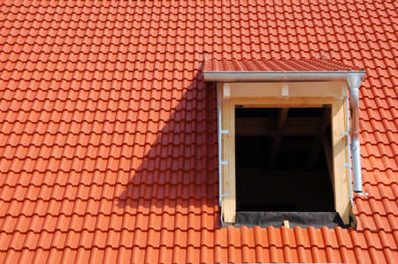 New construction of a roof with red tiles
