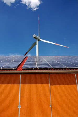 Solar panel and pole with a wind turbine Stock Photo - 3160253