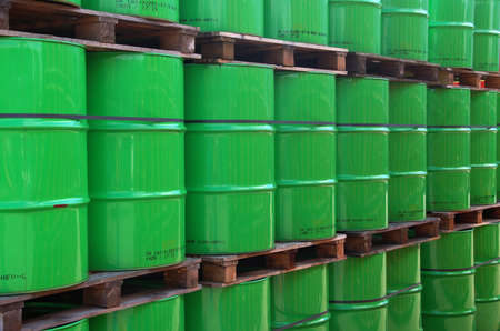 gasoil: Assembly of green oil drums on wooden palets Stock Photo
