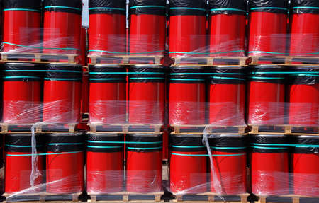 gasoil: Red oil drums wrappped in plastic on wooden pallets