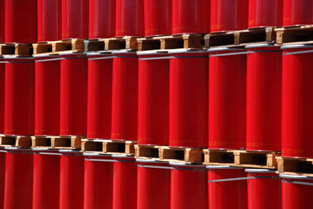 gasoil: Red oil drums on wooden pallets in an industrial storage