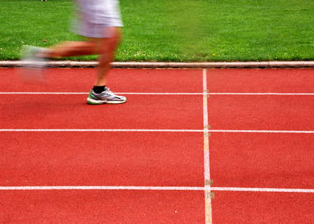 Athletic track with runner in motion Stock Photo - 3328125