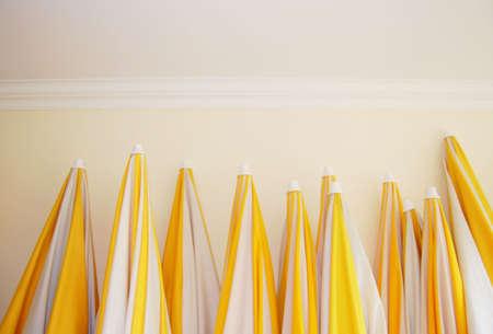 sunshades: Yellow and white striped sunshades Stock Photo