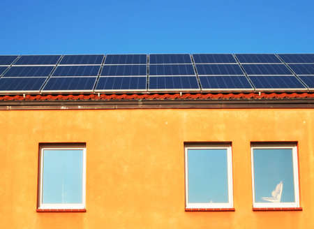 Solar energy panel on the roof of a house Stock Photo - 3948086