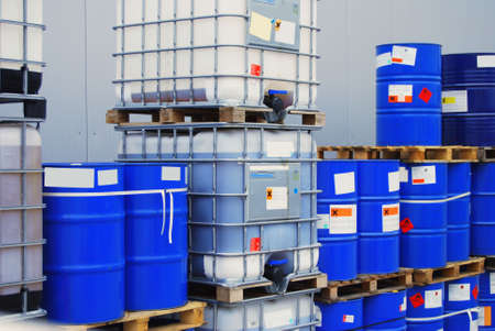 Blue chemical drums on pallets in a warehouse photo