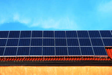 Solar energy panels on a school roof Stock Photo - 4545464