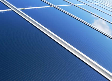 Diagonal view of a solar energy panel field with cloud reflection Stock Photo - 4708924