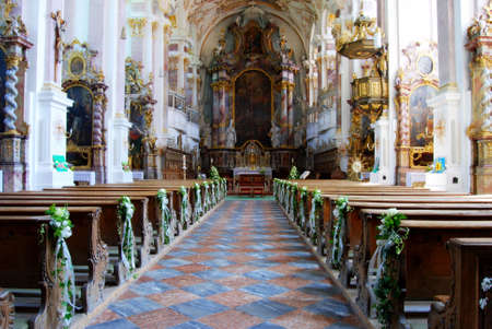 View into a rococo church with wedding decoration