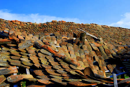 damaged roof: Damaged roof with colorful tiles Stock Photo