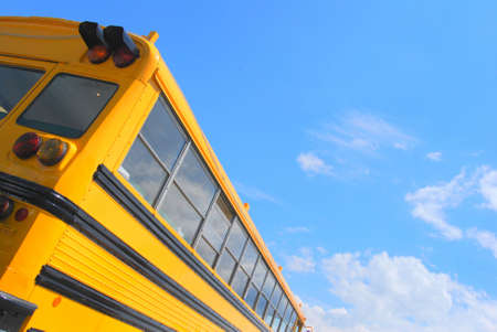 Yellow american school bus and a blue sky