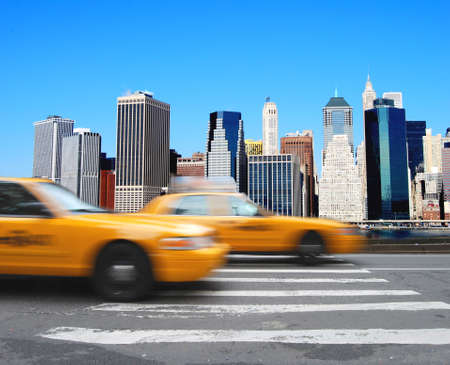 Yellow cabs in front of the Manhattan skyline in New York Stock Photo