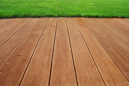 Hardwood floored terrace with green grass