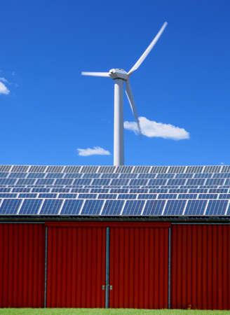 Solar energy panel and windmill on a farm