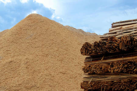 Wooden boards and wood chips for combustion in a biomass boiler