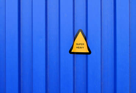 sidewall: Blue sidewall of a cargo container with a super heavy sign Stock Photo