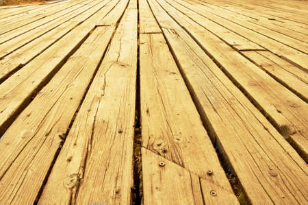 Wooden plank construction of a boardwalk photo
