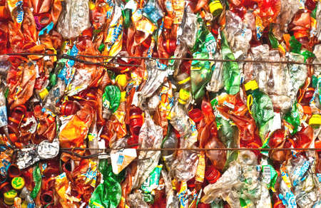 Packed and pressed plastic waste on a recycling site