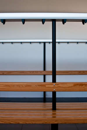 Bench and coat hooks in a locker room photo