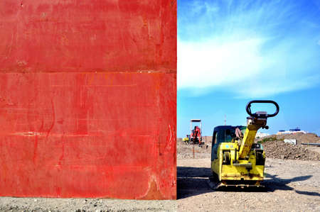 vibrator: Civil construction mechanical equipment and red wall