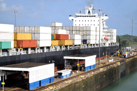 Big container ship in a sluice gate in the Panama canal Stock Photo