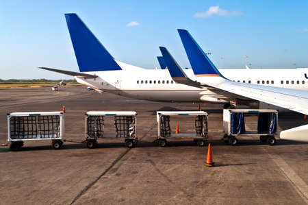 unload: Airplanes on a airplane with luggage cars