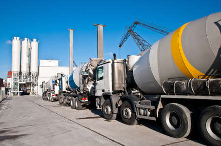 Concrete mixing trucks on an industrial site photo
