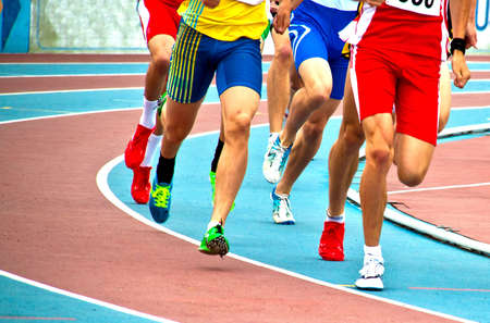 Men on an athleteic track during a long run Editorial