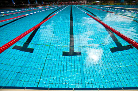 red competition: Swimming pool with red lines during a triathlon Editorial