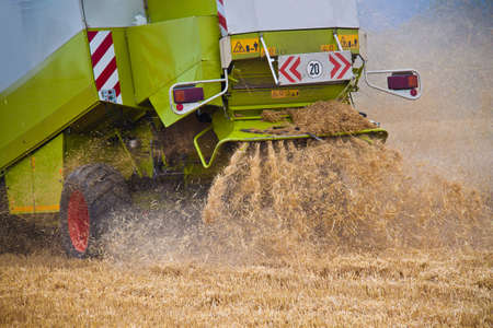 Combine harvester in work on a wheat field during harvest