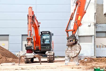 power shovel: Digger on a demolition site Editorial