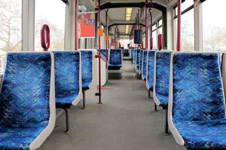 passenger vehicle: Vag�n vac�o de un tren de metro con asientos azules Foto de archivo