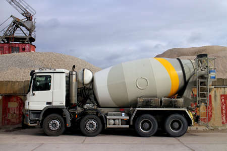 mixer: Concrete truck in front of a sand and gravel site