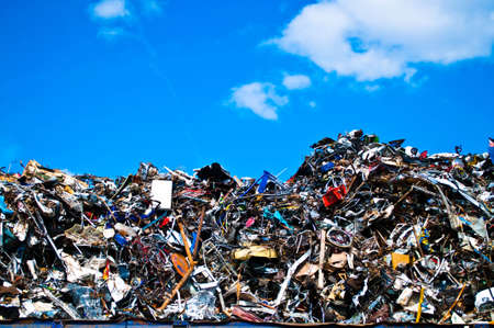 junk yard: Metal waste on a recycling plant with sky and clouds Stock Photo