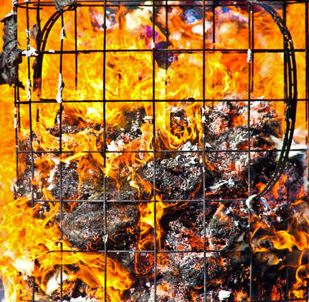 orange inferno: Fire with flames and remains of a burning container Stock Photo