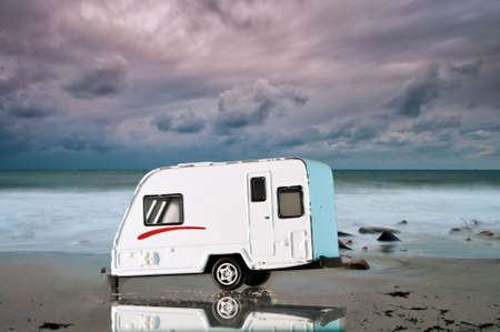 Camping car on the beach with a dramatic sky