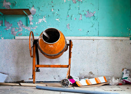 moveable: Moveable concrete mixer on a construction site Stock Photo