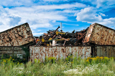 broken hill: Metal waste container on a junkyard Stock Photo