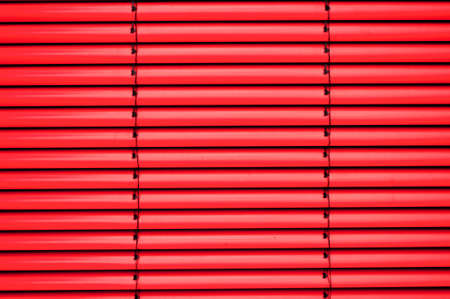 Red shutter blind in a house window photo