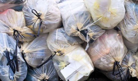 scrap trade: Municipal waste bags reared for recycling Stock Photo