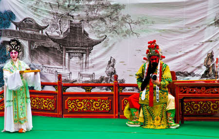 chinese opera: Actors of a chinese opera on a public stage in Hong Kong