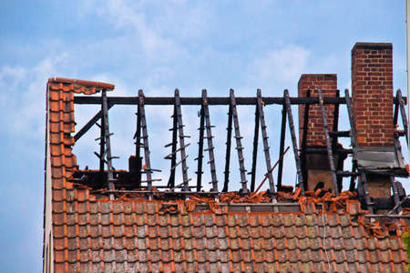 damaged roof: Damaged roof and missing tiles after a fire Stock Photo