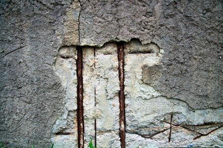 Damaged surface of a concrete wall Standard-Bild