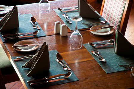 dinnerware: Restaurant table with glasses, plates and dinnerware
