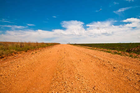 emptiness: Rough road with red sand in South Africa Stock Photo
